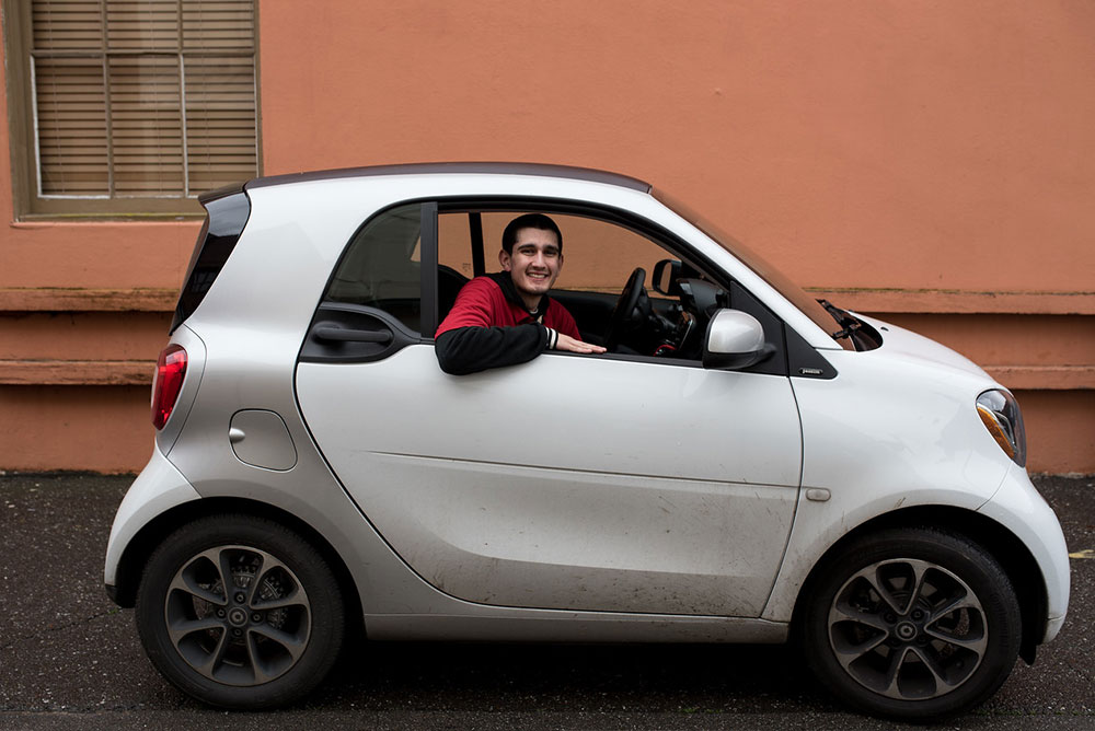 an image of the Corner Drug delivery car, a small beige colored Smart Car