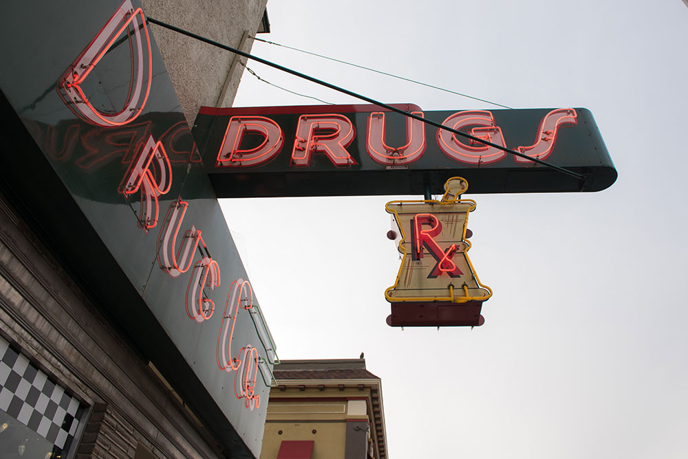 A photograph of the neon sign outside of Corner Drug in Woodland CA