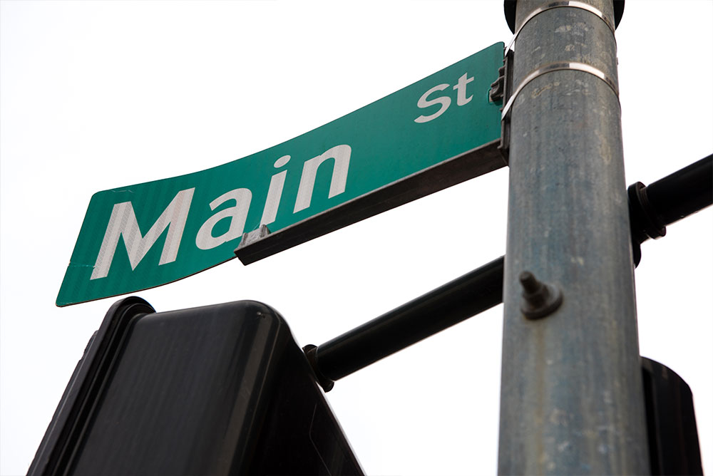 "a photograph of a street sign that reads ""Main Street"""